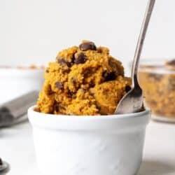 Edible pumpkin cookie dough in white bowl