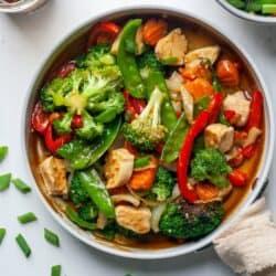 Paleo chicken stir fry with vegetables in skillet